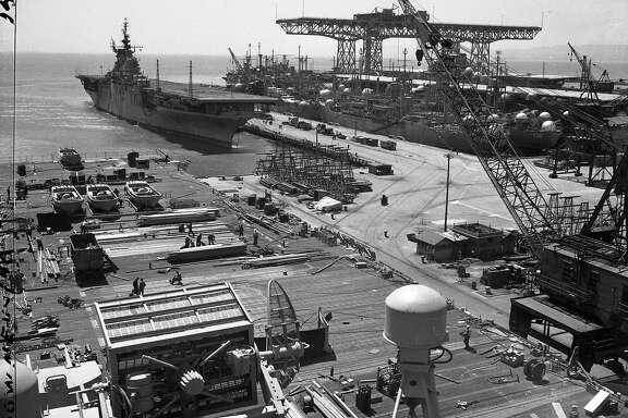 Massive bridge crane in the background at Hunters Point Naval Shipyard July, 1947