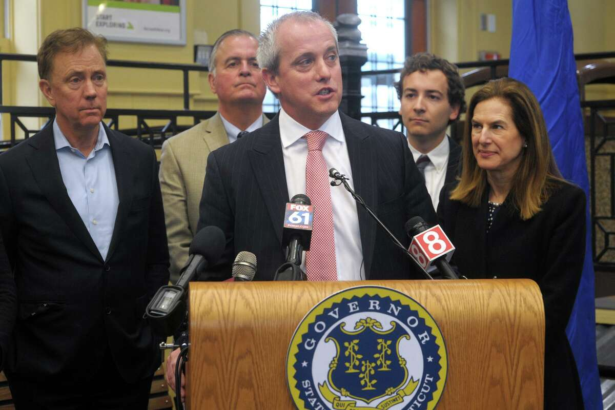 John Emra, President of AT&T in Connecticut, speaks during a news conference at the South Norwalk train station, in Norwalk, Conn. Jan. 6, 2020. Emra was joined by elected officials to announce a partnership with the State of Connecticut that will upgrade Internet access on Metro-North commuter trains between New Haven and Greenwich and create the infrastructure for the eventual transition to next-generation, high-speed 5G.