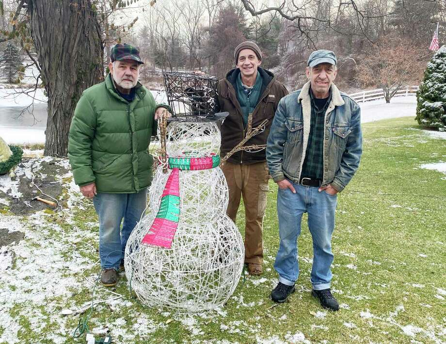 The volunteers who put up the lights at Walter Schalk's home on Drum Hill Road are, from left, Wayne Ranhosky, Tad Ventres and Don Warner. Dec. 2019 Photo: Contributed Photo / Walter Schalk / Wilton Bulletin Contributed