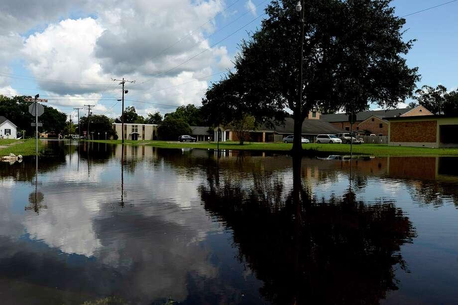 A flooded street in Orange on Tuesday.  Photo taken Tuesday 9/5/17 Ryan Pelham/The Enterprise Photo: Ryan Pelham / Ryan Pelham/The Enterprise / ©2017 The Beaumont Enterprise/Ryan Pelham
