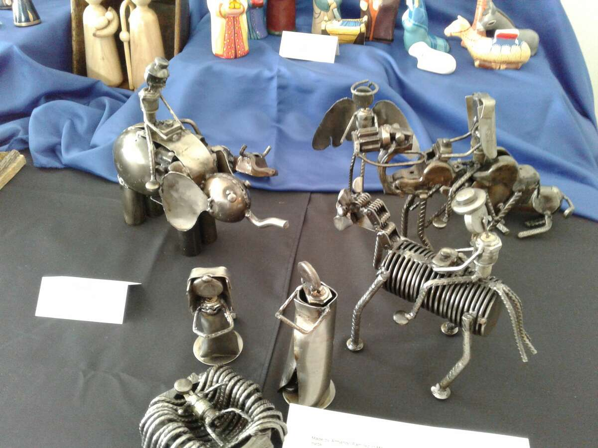 This metal nativity is made of discarded car parts.