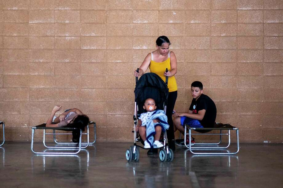 A family is seen at a shelter set up after a 5.8 earthquake damaged several houses in Guanica, Puerto Rico on January 6, 2020. - A 5.8-magnitude earthquake shook Puerto Rico on January 6, 2020, toppling some structures and causing power outages and small landslides but there were no reports of casualties, the US Geological Survey said. The quake, just off the US territory's southern Caribbean coastline, was felt throughout much of the island, including the capital San Juan. Some 250,000 customers were hit by electric power outages after the quake, which struck at 6:32 am local time (1032GMT). (Photo by Ricardo ARDUENGO / AFP) (Photo by RICARDO ARDUENGO/AFP via Getty Images) Photo: RICARDO ARDUENGO/AFP Via Getty Images