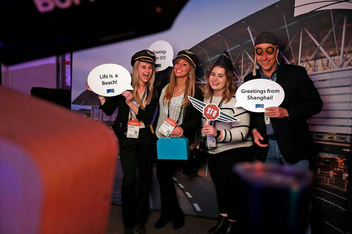 (left to right) Courtney Frickman, Christina Baur, Morgan Cutter and William Hendricks have a photo made at SFO booth during PCMA Convening Leaders 2020 party at Pier 48 in San Francisco, Calif., on Sunday, January 4, 2020.