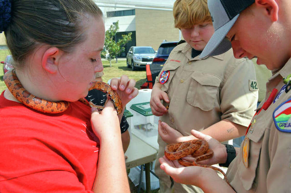 A female Scout displays snakes alongside fellow members of Boy Scouts of America at Hunting and Fishing Days at John A. Logan College in Carterville.