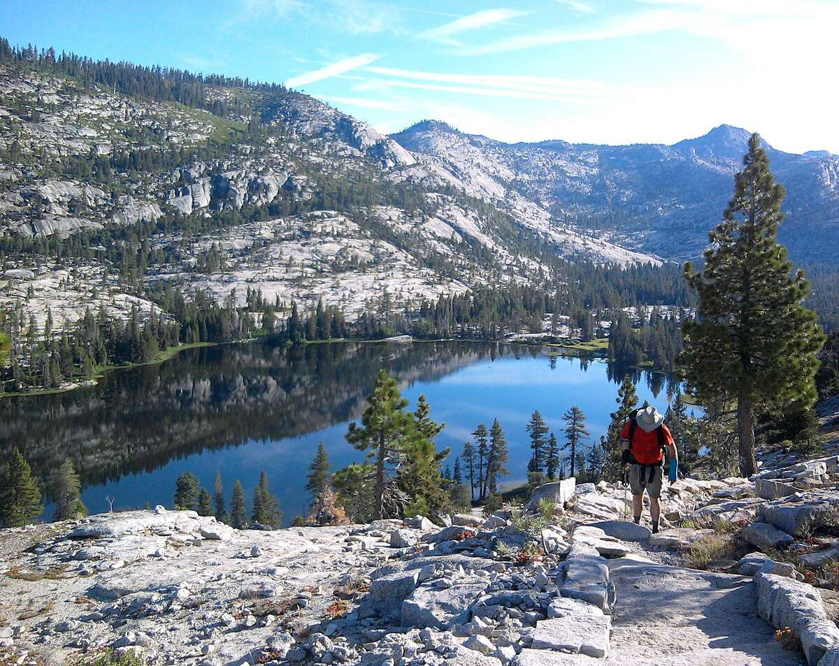 Michael Furniss hikes heads up trail from Lake Vernon on flank of Mount Gibson in Yosemite Wilderness