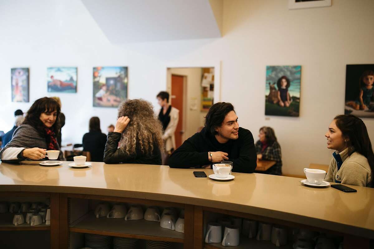 People enjoy their coffee at Flying Goat Coffee in Healdsburg, Calif. Saturday, Jan. 13, 2018.