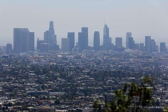 """The downtown Los Angeles, Calif. skyline is seen from Griffith Observatory on Monday, July 1, 2019. In a letter to Mary Nichols, chairwoman of the California Air Resources Board, obtained by McClatchy, the EPA said the two sides """"have made great progress"""" toward resolving the backlog of """"outdated, unnecessary or deficient"""" reports on the state's plans to combat pollutants. (Christina House/Los Angeles Times/TNS)"""