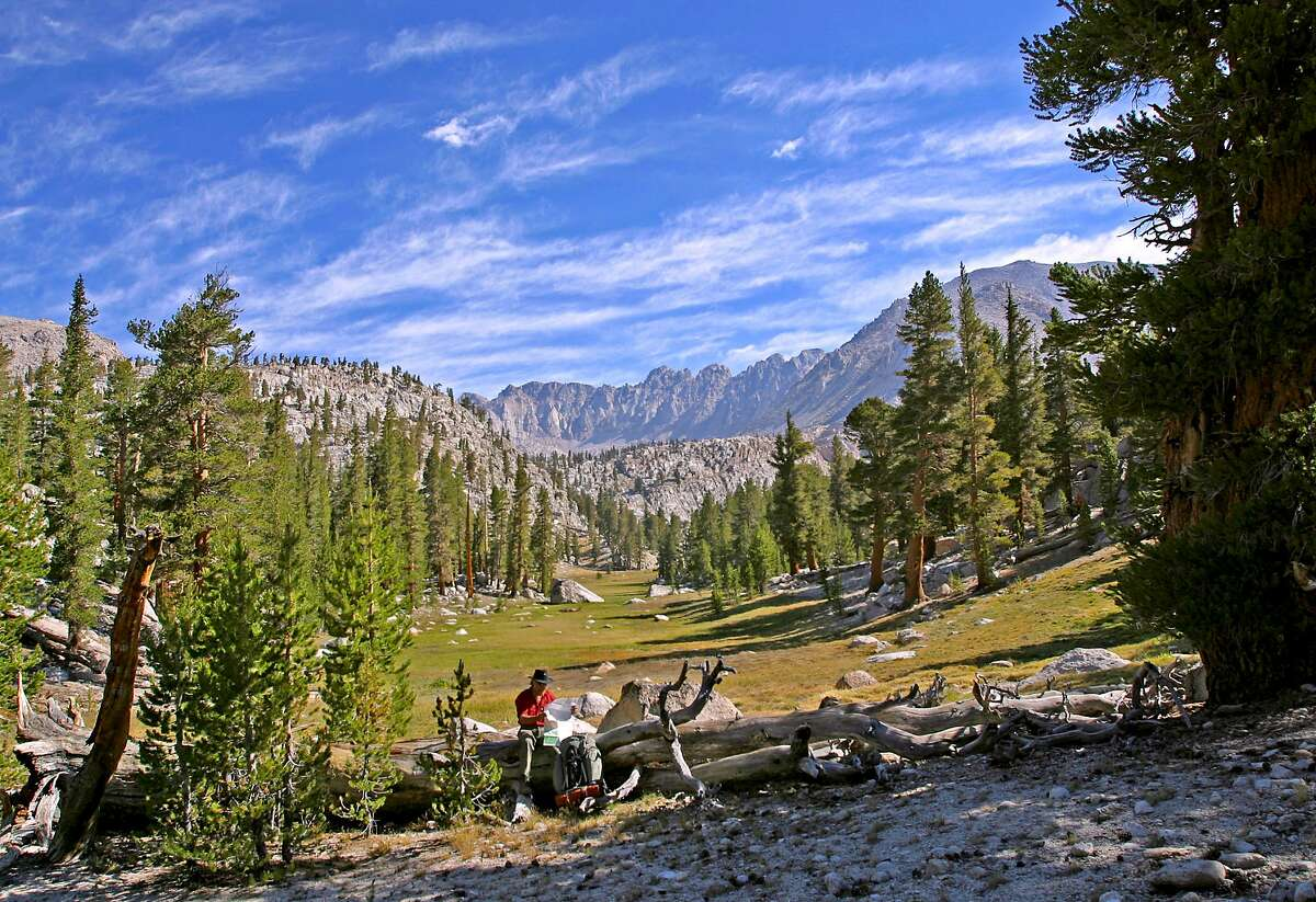 San Francisco Chronicle outdoors writer Tom Stienstra surveys map on Pacific Crest Trail at foot of Soldier Basin on flank of Mount Whitney