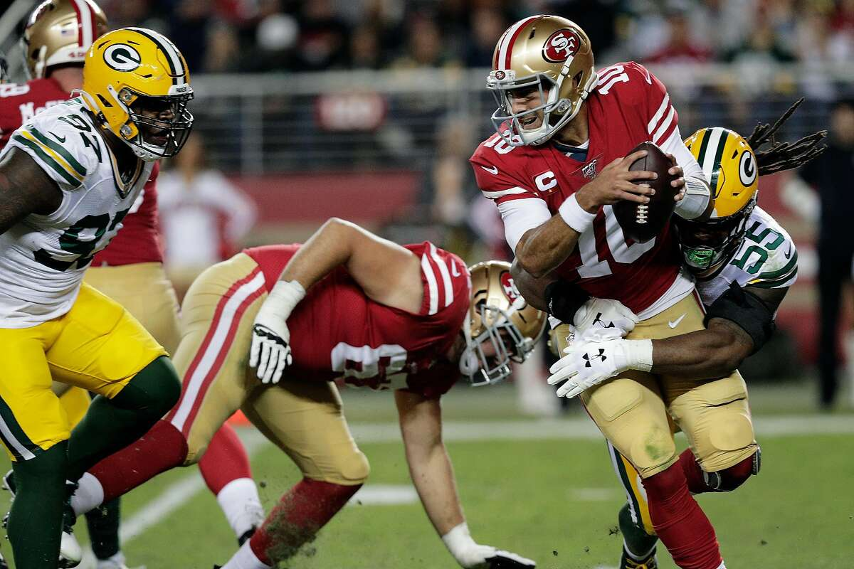 Jimmy Garoppolo (10) sacked by Za'Darius Smith (55) In the first half as the San Francisco 49ers played the Green Bay Packers at Levi's Stadium in Santa Clara, Calif., on Sunday, November 11/24/19, 2019.