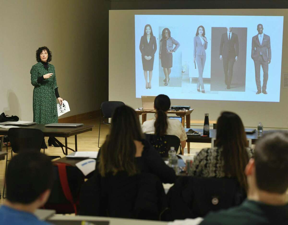 """Local stylist Maria Turkel, of Maria Turkel Professional Styling, presents """"What to Wear When You Want to Get Hired"""" during the """"Kickstart Your Job or Internship Search"""" event at Greenwich Library's Flinn Gallery in Greenwich, Conn. Monday, Jan. 6, 2020. College students home during winter break learned valuable tips to make themselves more hireable, including resume writing, creating a LinkedIn page, interview advice, networking skills, and were given professional headshots."""