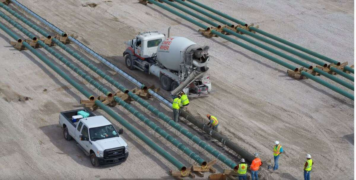 Contractors work on the initial stage of construction at the future Port Arthur LNG export facility in the Sabine Pass community of Port Arthur in early December. Port Arthur LNG is a proposed venture by Sempra LNG and Saudi Aramco.