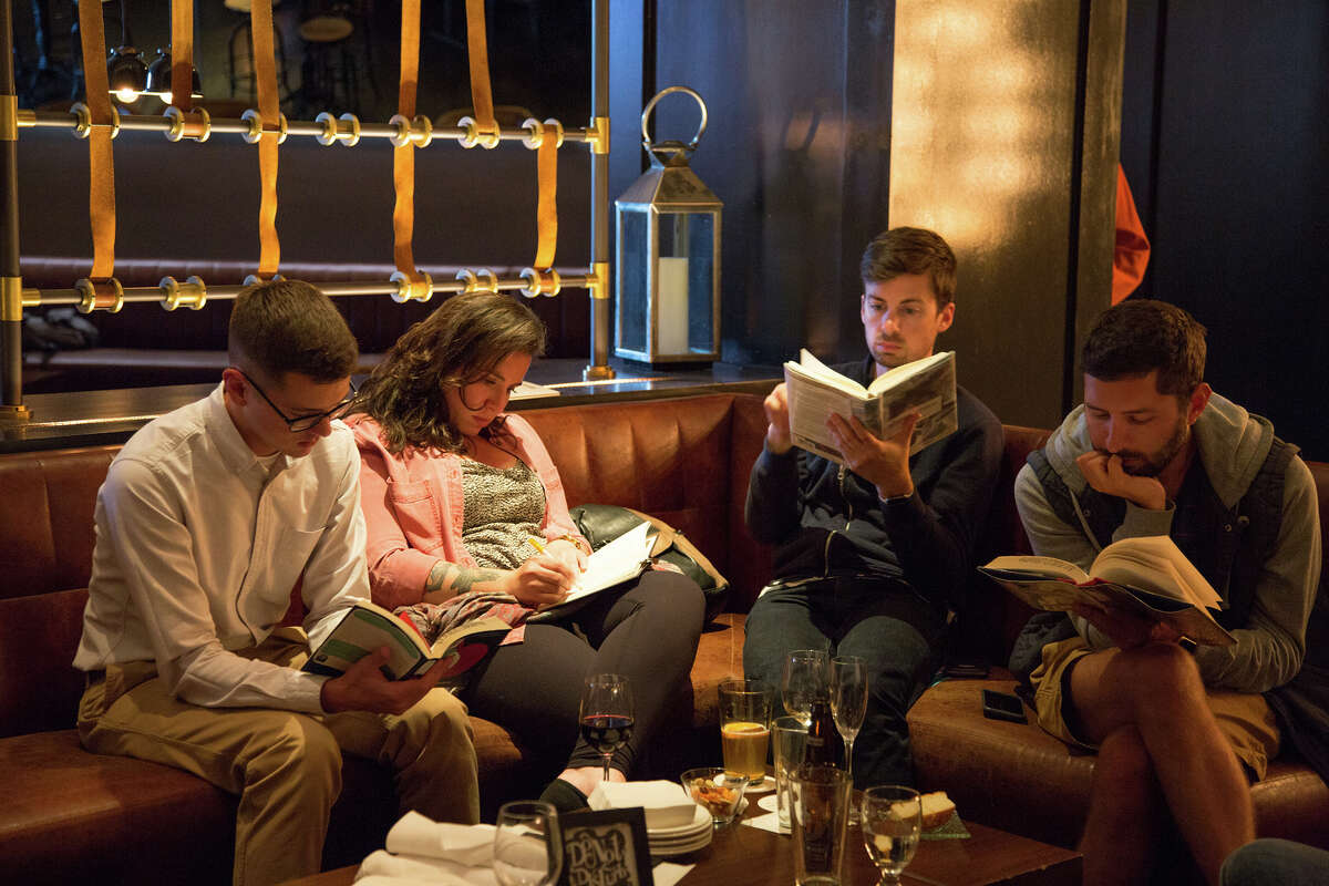 """Silent Book Club, otherwise known as """"Introvert Happy Hour,"""" started in San Francisco in 2012 with two friends reading together in a bar. Now, it has grown to 180 chapters across the world in 20 different countries."""