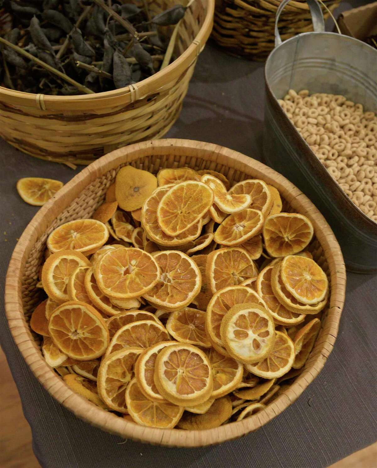 Orange slices and other materials were used at a Woodcock Nature Center wreath building workshop on Friday evening.