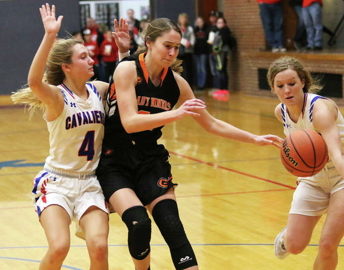 Gillespie's Keaton Link has the ball batted out of bounds from behind by Carlinville's Eryn Seal (right) while the Cavaliers' Jill Stayton (4) defends the break during the championship game of the Carlinville Holiday Tourney on Dec. 30. Both teams resume SCC play Thursday.