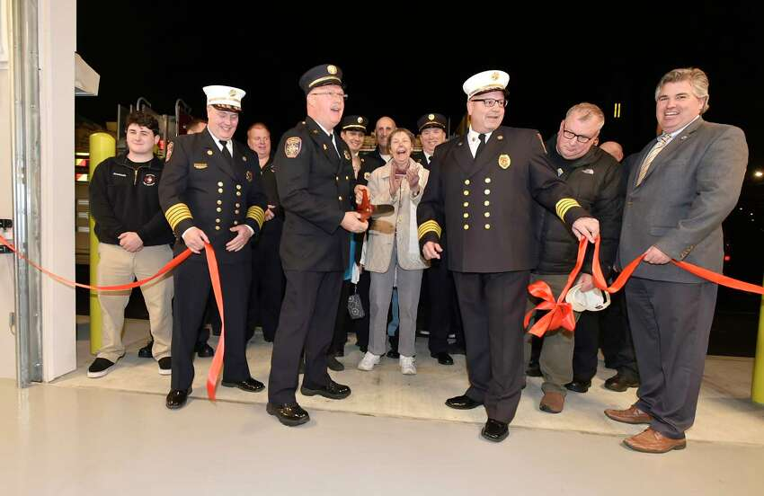 Branford, Connecticut - Monday, January 6, 2020: Branford Fire Chief Thomas Mahoney, Fire Captain Mike Mullen of Indian Neck Pine Orchard Co. 9, Branford Fire Commission Chairman Robert Massey, Jr., and Branford First Selectman Jamie Cosgrove, left to right, as the Town of Branford Fire Department celebrates their new Indian Neck Pine Orchard Co. 9 Fire House Monday evening with a ribbon cutting ceremony. The fire house is home to 14 volunteer firefighters.