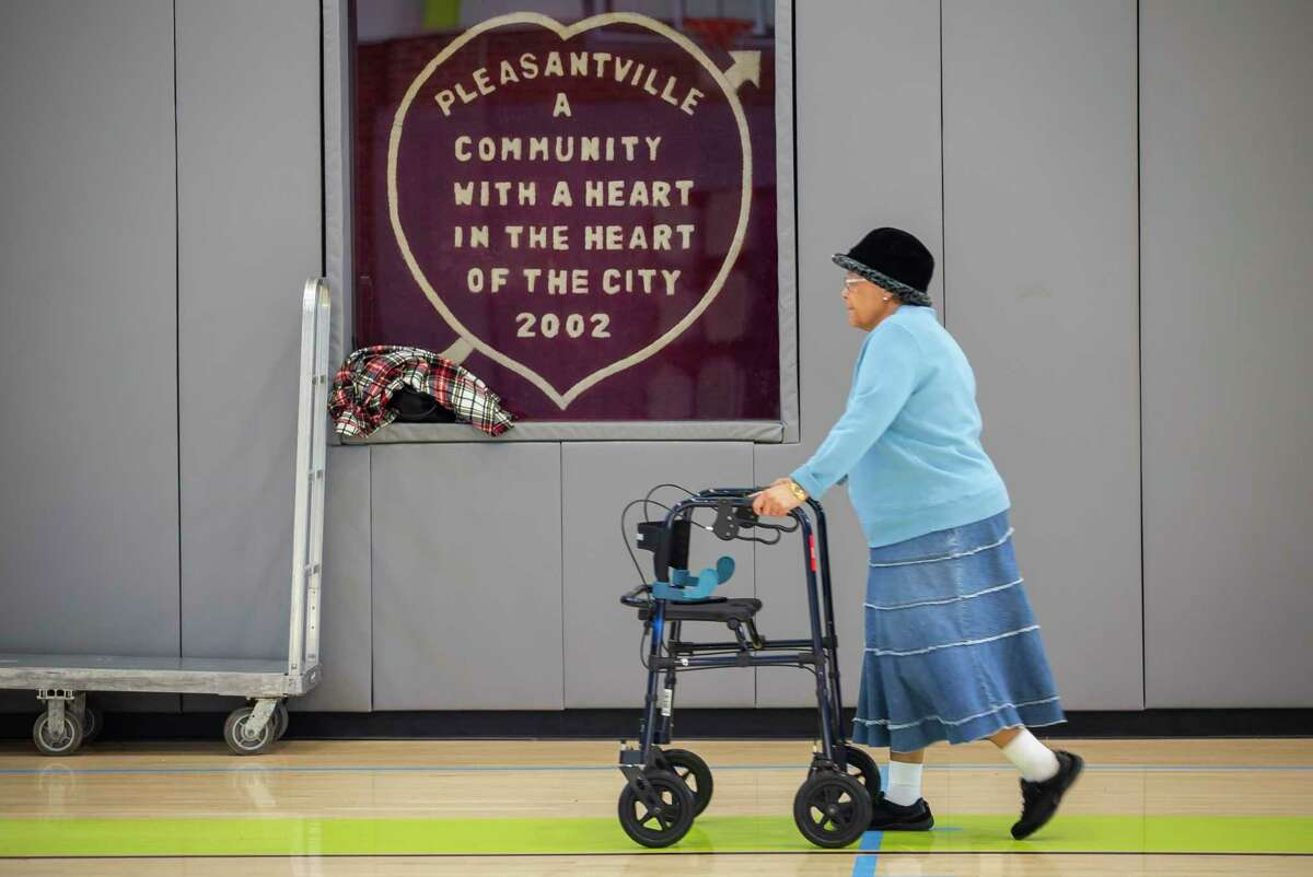 Essie Long walks for exercise inside they gymnasium at the J. Robinson, Sr., Community Center in the Pleasantville neighborhood of Houston, Tuesday, Dec. 17, 2019. Long's parents moved into the neighborhood in the 1950s when she was a teenager. Long moved back to the neighborhood in 1985 and has lived there since. Since its founding, the historic Pleasantville neighborhood on Houston's east side, has seen heavy industry displace residential areas and slowly surround the neighborhood's borders. Achieving Community Tasks Successfully, or ACTS, a community-based organization in the historic Pleasantville neighborhood, is partnering with several organizations, including the Environmental Defense Fund and universities like Texas Southern University, to establish its own community-owned air monitoring network. The solar-powered monitors are calibrated to nearby federal regulatory monitors and designed to detect a range of airborne toxins, including fine particles, nitrogen oxide and volatile organic compounds, all of which are harmful to human health.