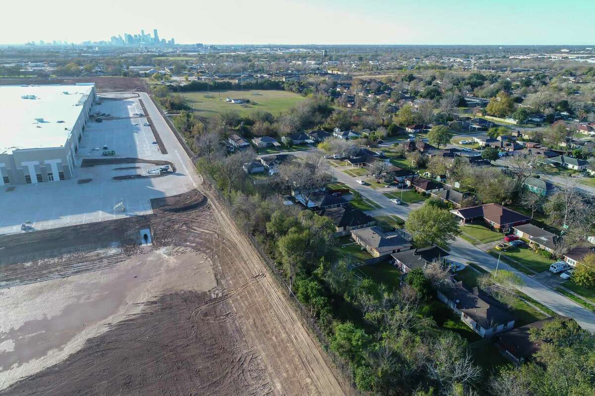 A new warehouse complex is being built on property that was once owned by Exxon and mandated for cleanup on the south side of the Pleasantville neighborhood of Houston, Tuesday, Dec. 17, 2019. An air monitor was planned for just north of the site, but property owners of a senior living community did not want to participate in the project. Since its founding, the historic Pleasantville neighborhood on Houston's east side, has seen heavy industry displace residential areas and slowly surround the neighborhood's borders. Achieving Community Tasks Successfully, or ACTS, a community-based organization in the historic Pleasantville neighborhood, is partnering with several organizations, including the Environmental Defense Fund and universities like Texas Southern University, to establish its own community-owned air monitoring network. The solar-powered monitors are calibrated to nearby federal regulatory monitors and designed to detect a range of airborne toxins, including fine particles, nitrogen oxide and volatile organic compounds, all of which are harmful to human health.