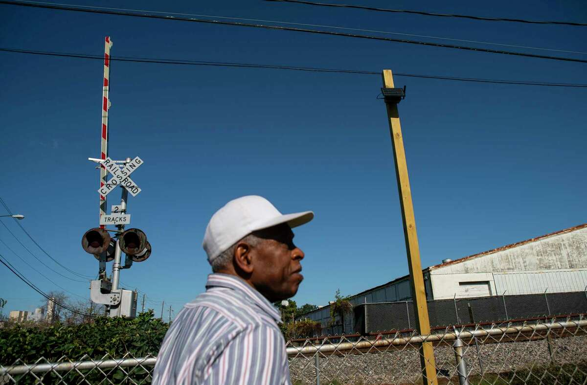 Cleophus Sharp, who first moved to the Pleasantville neighborhood in 1951, looks at one of the solar-powered air monitors he helped install at one of the entrances to the historic east side community in Houston, Tuesday, Dec. 17, 2019. Since its founding, the historic Pleasantville neighborhood on Houston's east side, has seen heavy industry displace residential areas and slowly surround the neighborhood's borders. Achieving Community Tasks Successfully, or ACTS, a community-based organization in the historic Pleasantville neighborhood, is partnering with several organizations, including the Environmental Defense Fund and universities like Texas Southern University, to establish its own community-owned air monitoring network. The solar-powered monitors are calibrated to nearby federal regulatory monitors and designed to detect a range of airborne toxins, including fine particles, nitrogen oxide and volatile organic compounds, all of which are harmful to human health.
