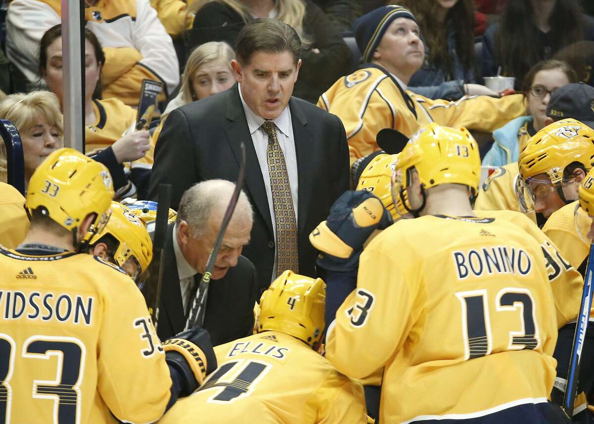 FILE - In this Dec. 29, 2018, file photo, Nashville Predators coach Peter Laviolette, center, and associated coach Kevin McCarthy, center left, talk to players during a timeout in an NHL hockey game against the New York Rangers in Nashville, Tenn. The team announced Monday, Jan. 6, 2020, that both Laviolette and McCarthy had been fired. (AP Photo/Mark Humphrey, File)