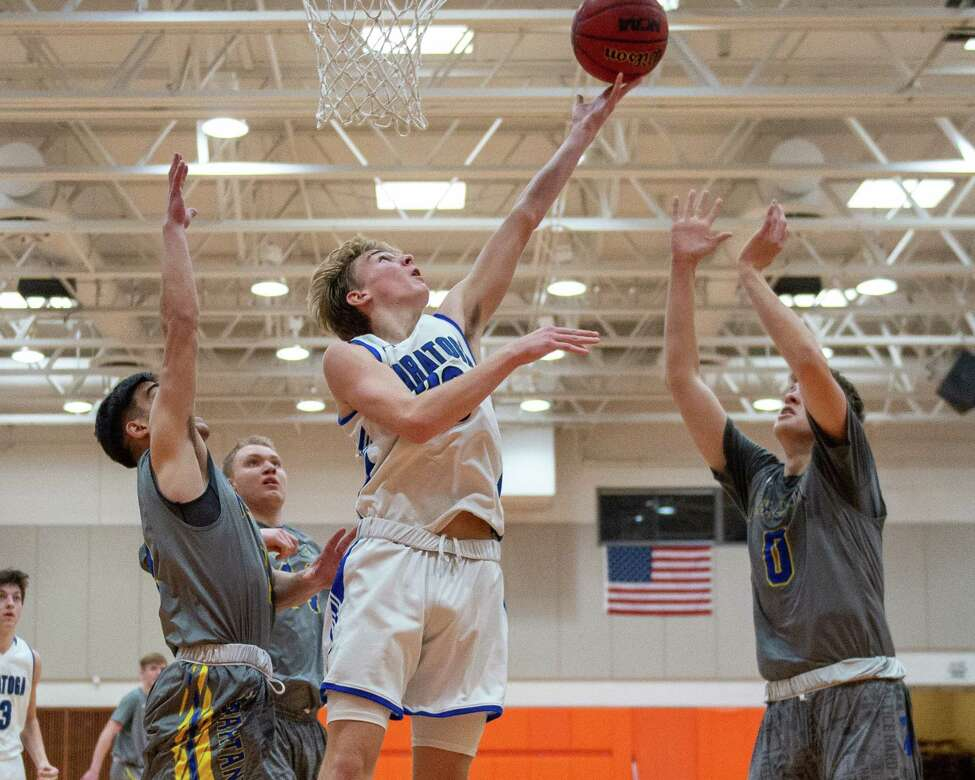 Saratoga junior Luke Britton lays one in in front of three Maine Endwell defenders during the Cobleskill Classic Basketball Tournament at SUNY Cobleskill on Saturday, Dec. 21, 2019 (Jim Franco/Special to the Times Union.)