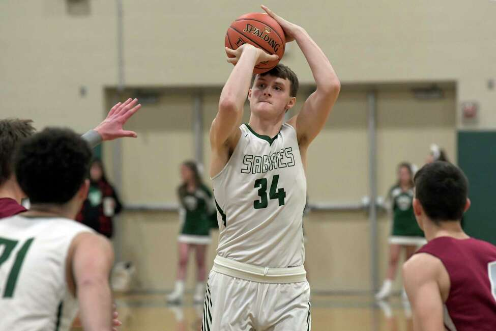 Schalmont's Shane O'Dell (34) puts up a shot against Watervliet's during the first half of a Section II boys' basketball game Friday, Dec. 20, 2019, in Rotterdam, N.Y. (Hans Pennink / Special to the Times Union) ORG XMIT: 122119_hsbb_HP104