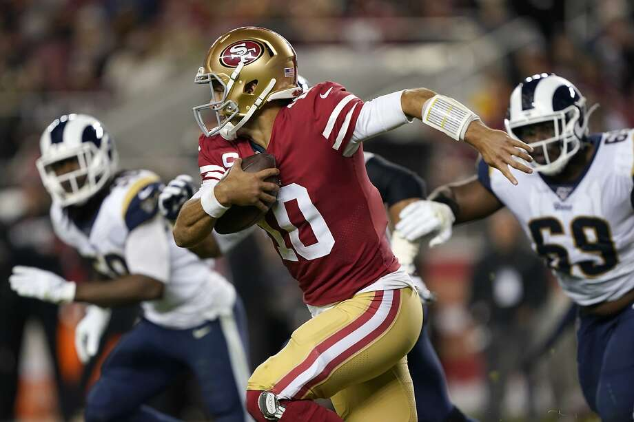 San Francisco 49ers quarterback Jimmy Garoppolo (10) runs against the Los Angeles Rams during the second half of an NFL football game in Santa Clara, Calif., Saturday, Dec. 21, 2019. (AP Photo/Tony Avelar) Photo: Tony Avelar, Associated Press