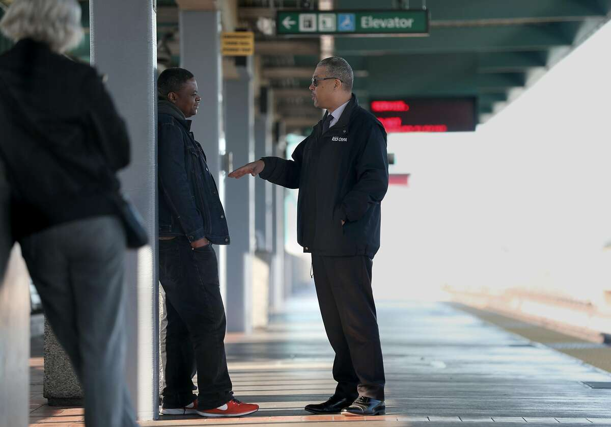 BART's independent police inspector general Russell Bloom (middle) talks with commuter Jean Bikindou (left) from Oakland while he waits for the Richmond bart train on Monday, Jan. 6, 2020, in Oakland, Calif.