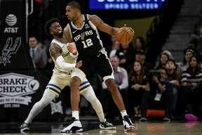 San Antonio Spurs' LaMarcus Aldridge tries to get past Milwaukee Bucks' Wesley Matthews during the Spurs' game against the Bucks at AT&T Center in San Antonio, Texas, Jan. 6, 2020.