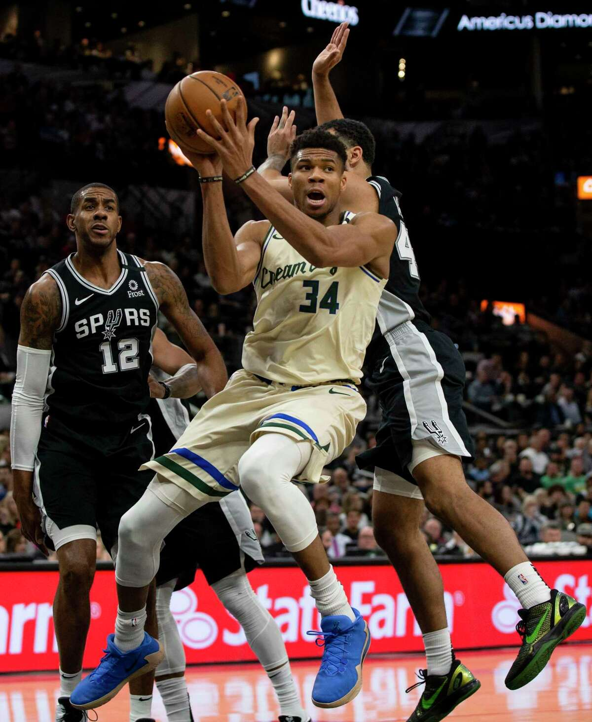 Milwaukee Bucks' Giannis Antetokounmpo goes up for a shot as the San Antonio Spurs try to block him during the Spurs' game against the Bucks at AT&T Center in San Antonio, Texas, Jan. 6, 2020.