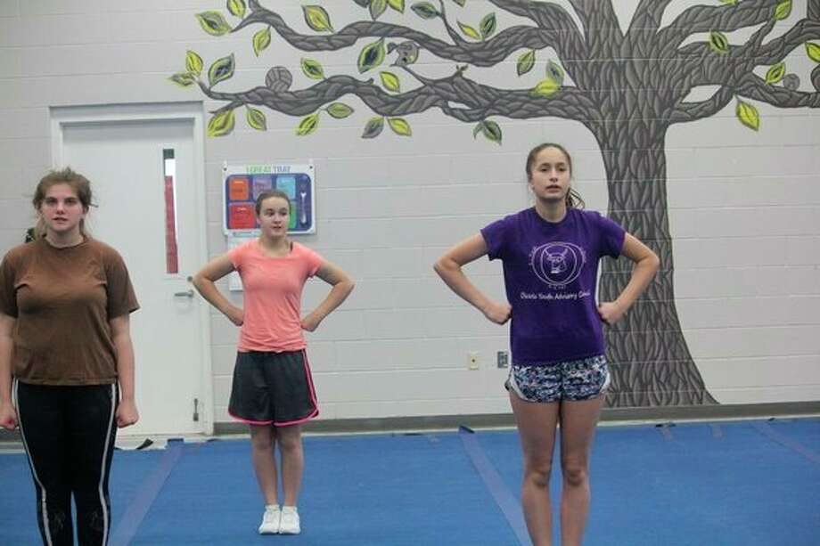 Evart cheerleaders preparing for a practice on Friday at the school include (from left) Emily Beemer, Madison Hunt and Mari Flachs. (Pioneer phtoto/John Raffel)