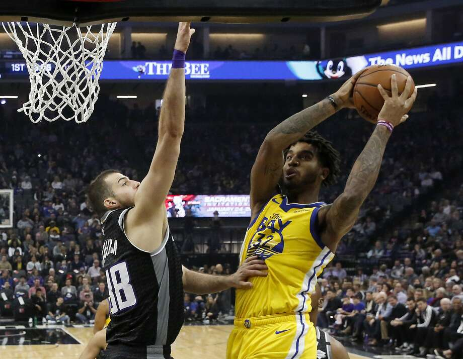 Golden State Warriors forward Marquese Chriss, right, goes to the basket against Sacramento Kings forward Nemanja Bjelica during the first quarter of an NBA basketball game in Sacramento, Calif., Monday, Jan. 6, 2020. (AP Photo/Rich Pedroncelli) Photo: Rich Pedroncelli / Associated Press
