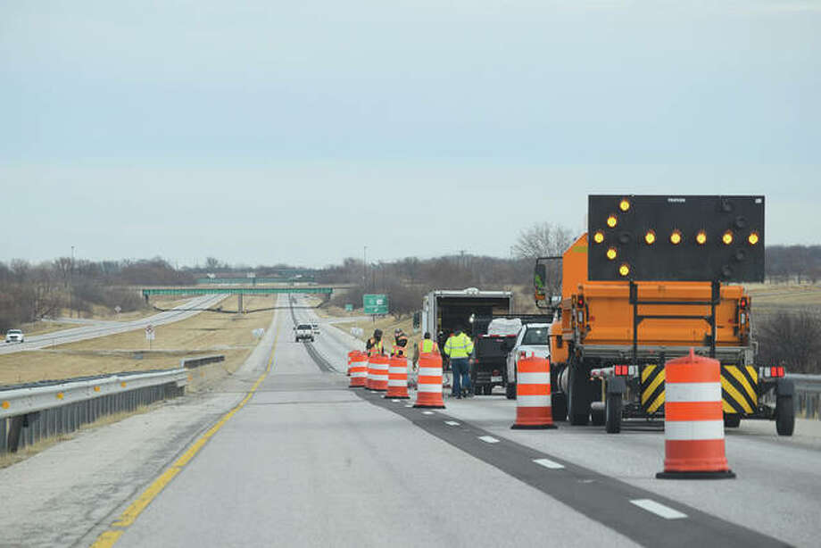 Illinois Department of Transportation workers fix a pothole that appeared Monday on Interstate 72 between the Morton Avenue and South Jacksonville exits.
