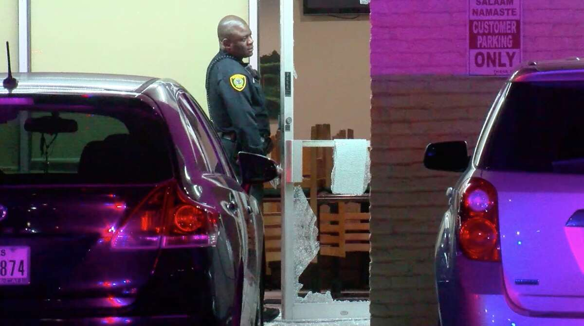 Houston police officers investigate a violent robbery inside a restaurant in the 10700 block of West Bellfort Avenue on Tuesday, Jan. 7, 2020.