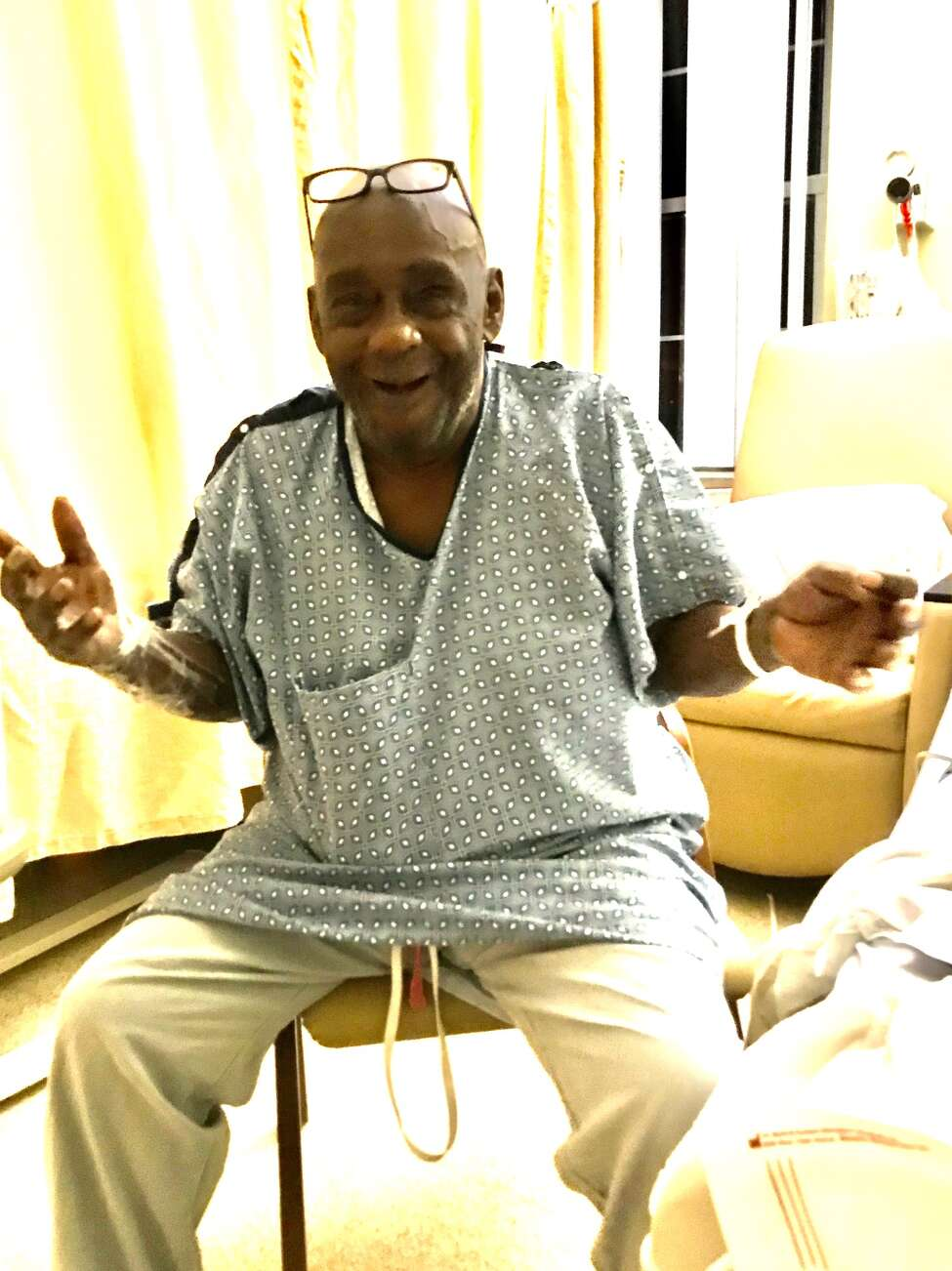 Leon Van Dyke, a founder of The Brothers, an Albany civil rights group, gestures to a visitor at Albany Medical Center.
