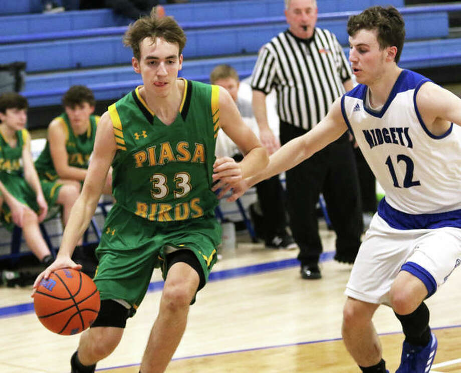 Southwestern junior Addis Moore (left), shown driving on Freeburg's Austin Lickenbrock in a Dec. 23 game at Freeburg, finished with 18 points and 18 rebounds Monday night in a Piasa Birds win over North Greene in White Hall. Photo: Greg Shashack | The Telegraph