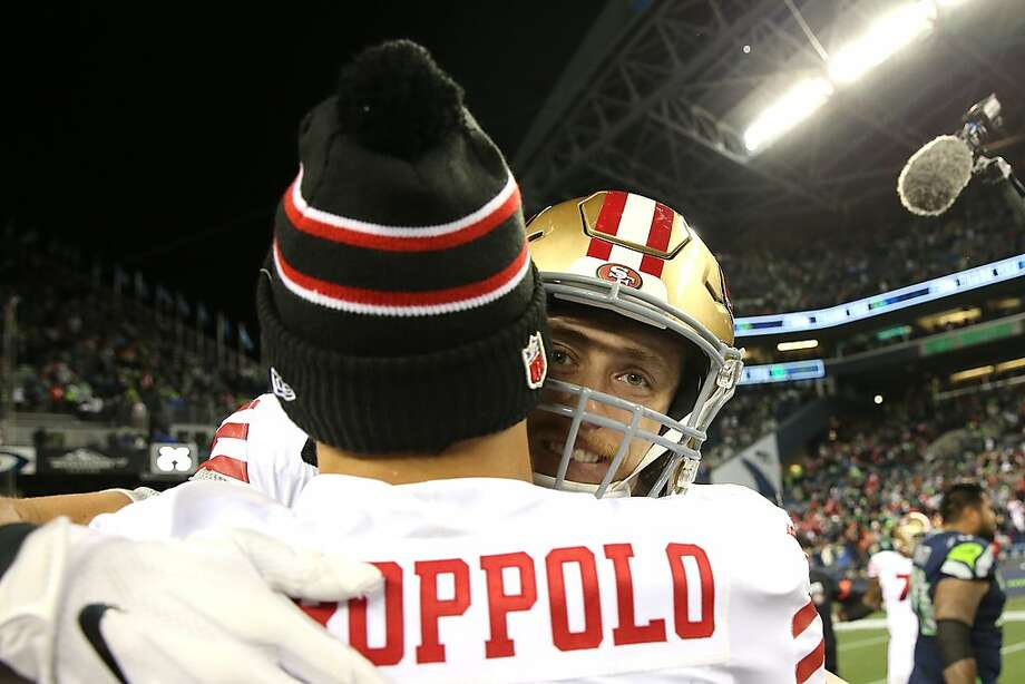 SEATTLE, WASHINGTON - DECEMBER 29: Jimmy Garoppolo #10 and George Kittle #85 of the San Francisco 49ers celebrate after defeating the Seattle Seahawks 26-21 during their game at CenturyLink Field on December 29, 2019 in Seattle, Washington. (Photo by Abbie Parr/Getty Images) Photo: Abbie Parr / Getty Images