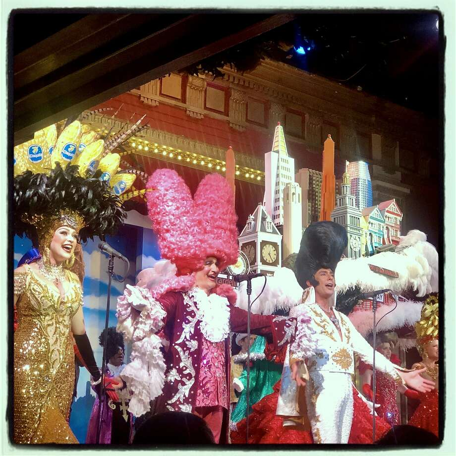 """Curt Branom (center) dressed as King Louis at the """"Beach Blanket Babylon"""" finale. Dec. 31, 2019. Photo: Catherine Bigelow / Special To The Chronicle"""