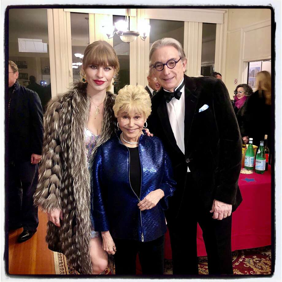 """Ivy Getty (left) with producer Jo Schuman Silver and Michael Tilson Thomas at the """"Beach Blanket Babylon"""" finale. Dec. 31, 2019. Photo: Catherine Bigelow / Special To The Chronicle"""