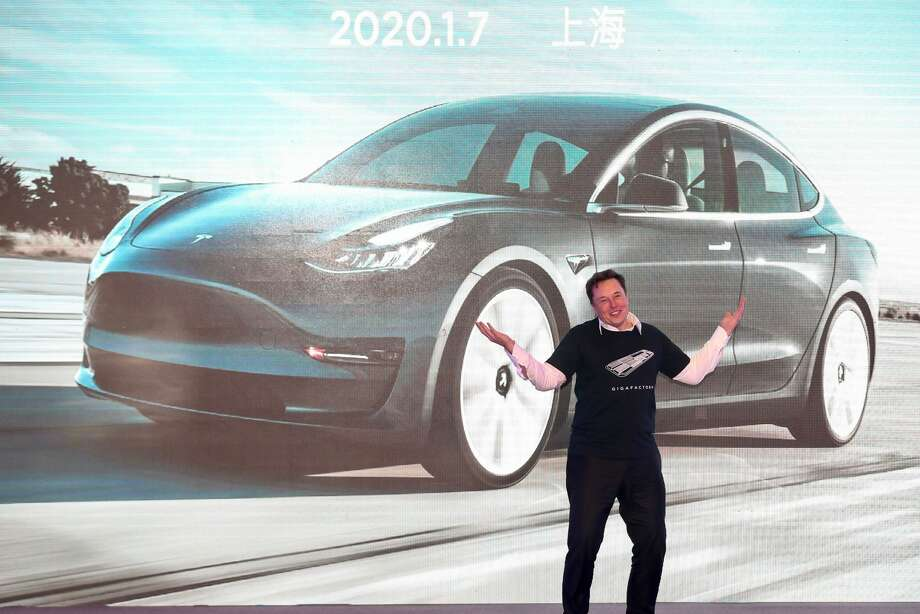 Tesla CEO Elon Musk gestures during the Tesla China-made Model 3 Delivery Ceremony in Shanghai. Photo: STR/AFP Via Getty Images