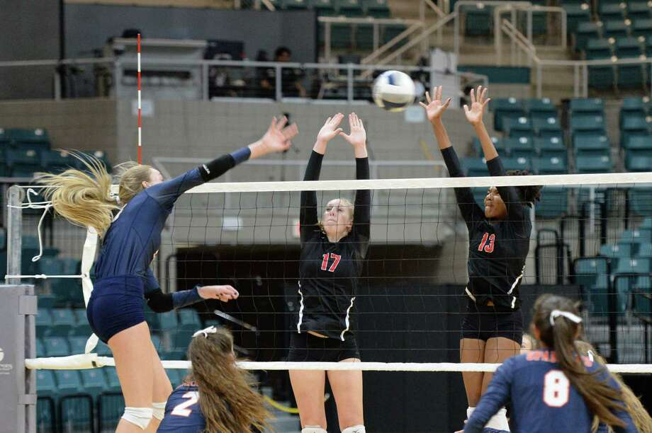 Sydney Piemons (17) and Gabby Johnson (13) of Austin try to defend a shot being made by Ally Batenhorst (14) of Seven Lakes during the first set of a Class 6A Region III bi-district volleyball playoff match between the Seven Lakes Spartans and the Ft. Bend Austin Bulldogs on Tuesday, November 5, 2019 at the Leonard Merrell Center, Katy, TX. Photo: Craig Moseley, Staff / Staff Photographer / ?2019 Houston Chronicle