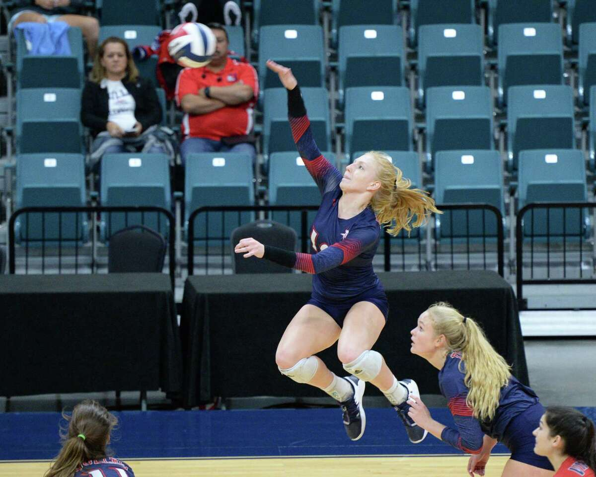 Kylie Mueller (10) of Dulles makes a shot during the third set of a Class 6A Region III bi-district volleyball playoff match between the Dulles Vikings and the Katy Tigers on Monday, November 4, 2019 at the Leonard Merrell Center, Katy, TX.