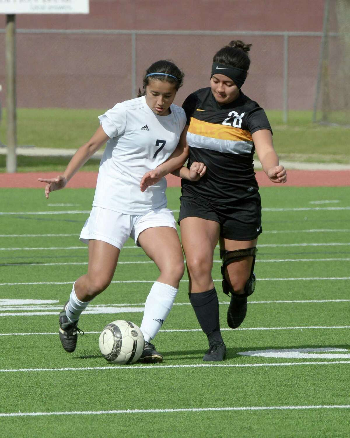 Prasna Neupane (7) of Clements and Natalie Guandique (28) of St. Agnes compete for a ball during the second half of a high school soccer game between the Clements Rangers and the St. Agnes Tigers in the I-10 Shootout on Thursday, January 10, 2019 at Cinco Ranch High School, Katy, TX.