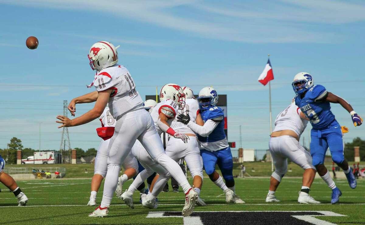 Memorial quarterback Matthew Sanders (11) passes against Cy Creek at Ken Pridgeon Stadium on November 12, 2019 at in Houston, TX.
