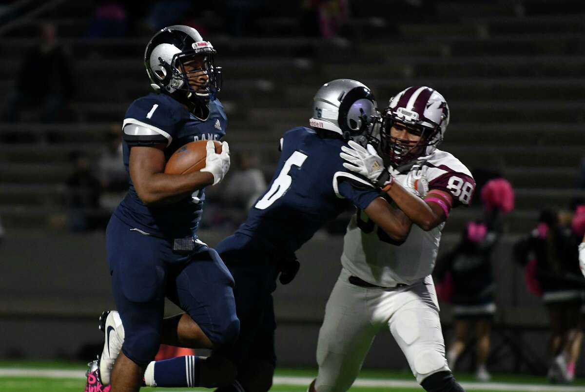 Cy Ridge senior running back Leslie Wellington skips into the end zone behind teammate Justin Austin's block on Northbrook defender Juan Martinez (88) during their District 17-6A matchup at Pridgeon Stadium in Cypress on Oct. 17, 2019.