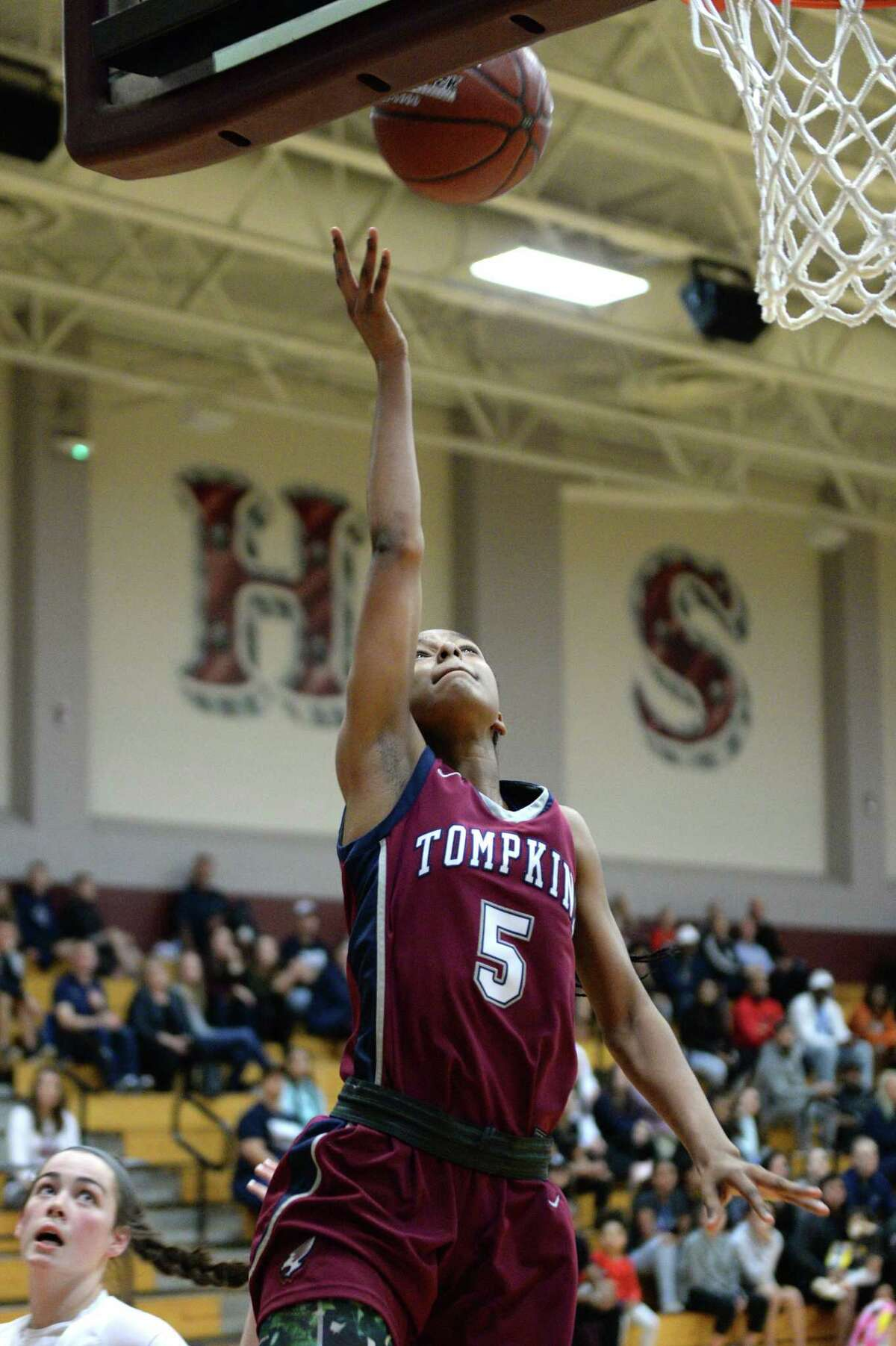 Crystal Smith (5) of Tompkins attempts a lay-up on a fast break during the first quarter of a 6A Region III District 19 Girls basketball game between the Cinco Ranch Cougars and the Tompkins Falcons on Friday, January 3, 2020 at Cinco Ranch HS, Katy, TX.