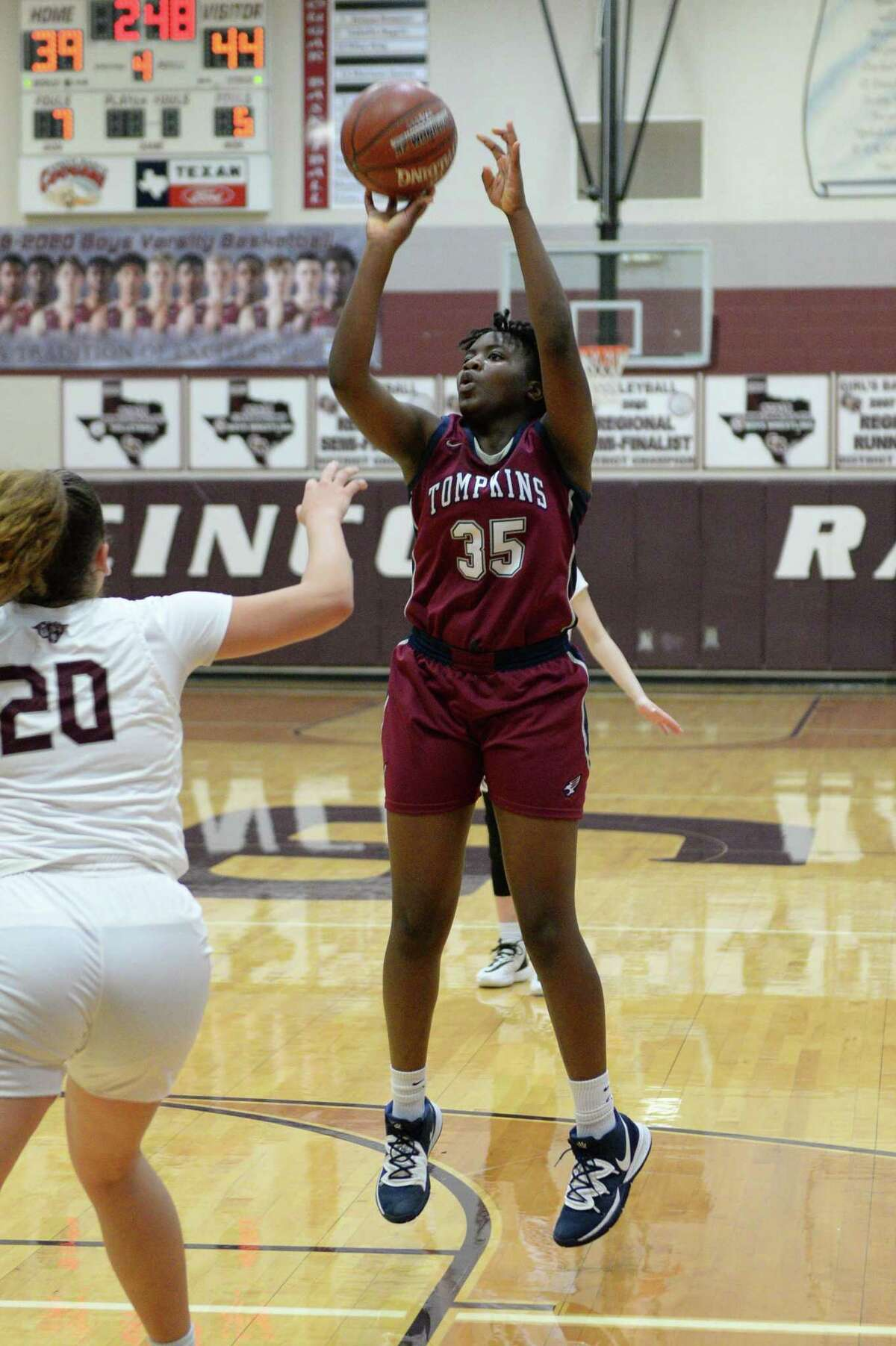 Fiyin Adeleye (35) of Tompkins attempts a jump shot during the fourth quarter of a 6A Region III District 19 Girls basketball game between the Cinco Ranch Cougars and the Tompkins Falcons on Friday, January 3, 2020 at Cinco Ranch HS, Katy, TX.