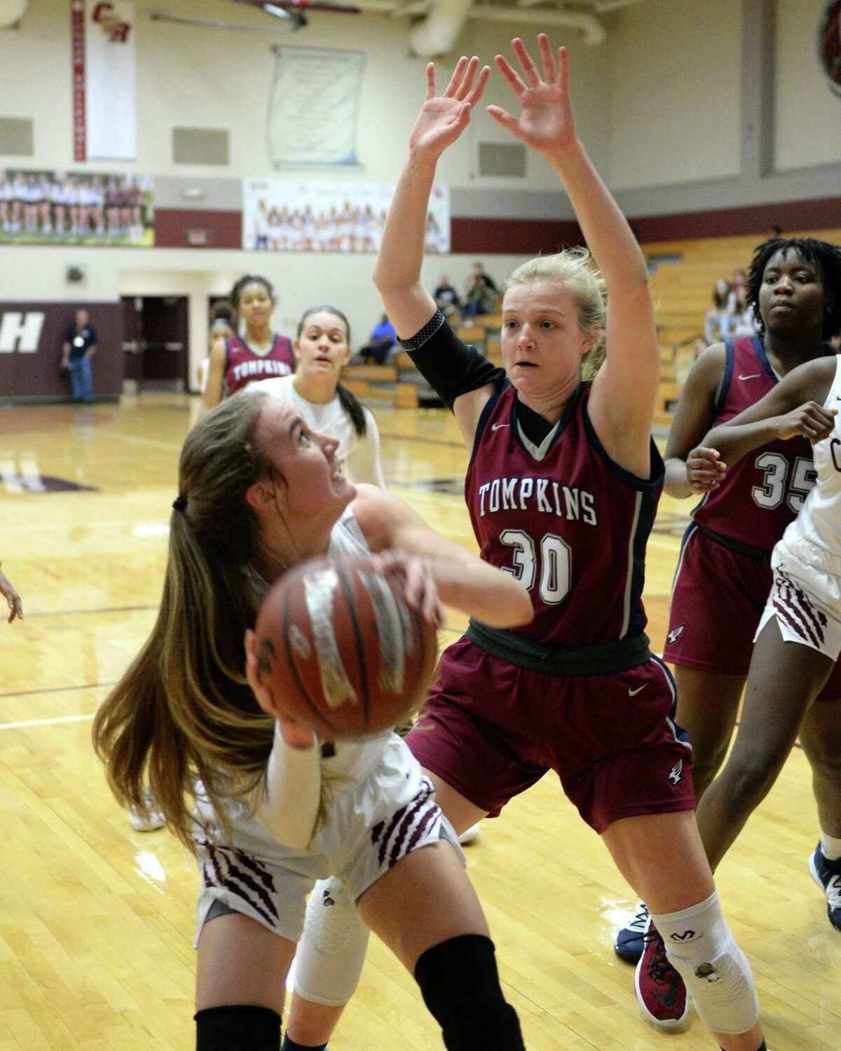 MacKenzie Durnford (30) of Tompkins defends against a shot by Catherine Hursh (1) of Cinco Ranch during the first quarter of a 6A Region III District 19 Girls basketball game between the Cinco Ranch Cougars and the Tompkins Falcons on Friday, January 3, 2020 at Cinco Ranch HS, Katy, TX.