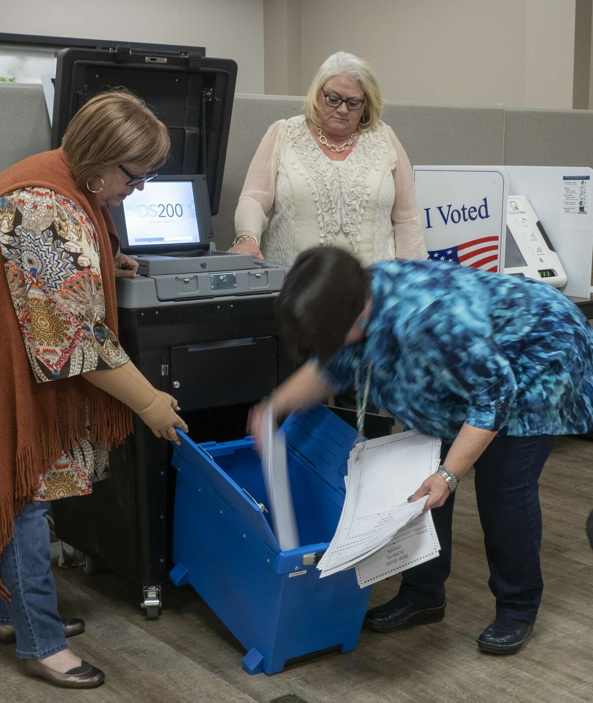 Bebra Land removes the voting cards from the machine 01/07/20 after Carolyn Grays and Beth Shock ran them through during testing at the Midland County Elections office. Tim Fischer/Reporter-Telegram