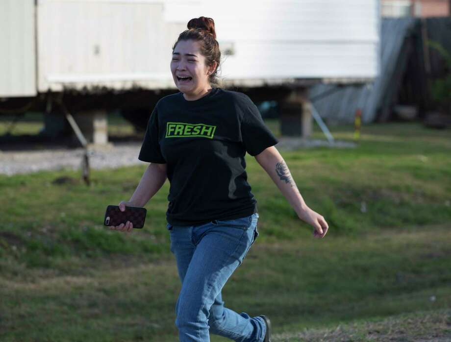 A woman react after learning the deceased male with at least one gunshot wound found at the 3800 block of Morelos Road is possibly her husband on Tuesday, Jan. 7, 2020, in Baytown. Officials believe this deceased male was related to a gun shop burglary at the 2000 block of the Kennings Road in Crosby. Photo: Yi-Chin Lee, Staff Photographer / © 2020 Houston Chronicle