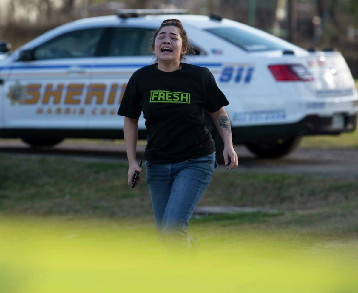 A woman reacts after learning the deceased male with at least one gunshot wound found at the 3800 block of Morelos Road is possibly her husband on Tuesday, Jan. 7, 2020, in Baytown. Officials believe this deceased male was related to a gun shop burglary at the 2000 block of the Kennings Road in Crosby.